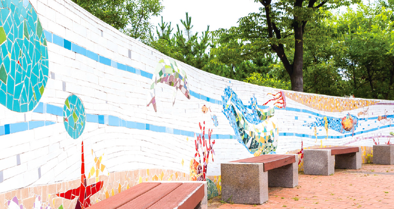 Wall Painting and Benches next to Central Fountain at Haedoji Park